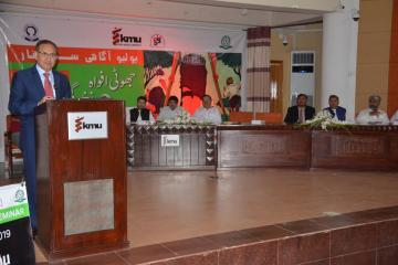 04.VC KMU Dr Arshad Javaid talking to Polio Agahi Seminar organized by KMU PHA,Secratary Health KP Dr Faruq Jamil along with others also sitting on stage1562666184.JPG