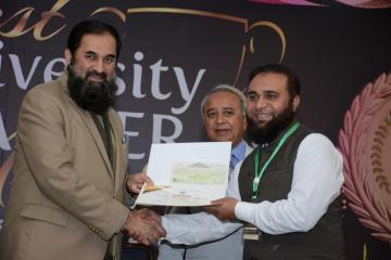 Director KMU -IPH&SS recieving HEC best Teacher award from Fedral Minister for Educaiton & Professional Training Eng. Baligh ur Rehman15203221121520924833.JPG